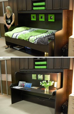 Bed folds away to reveal a desk