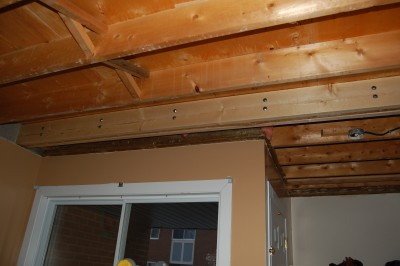 Sister Joists Attached To The Split Joist With Carriage Bolts.