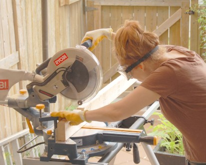 Cutting dado notches in 2 x 4s with a sliding compound mitre saw.