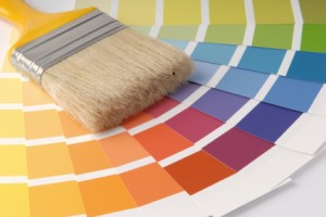 choosing paint colours - paint swatches and paintbrush