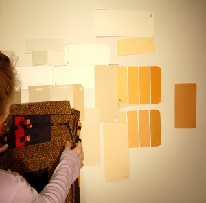 Taping swatches to a wall allows you to evaulate their compatability with your decor elements