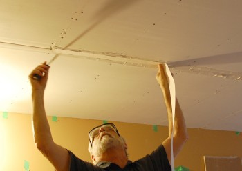 placing paper tape in a drywall seam